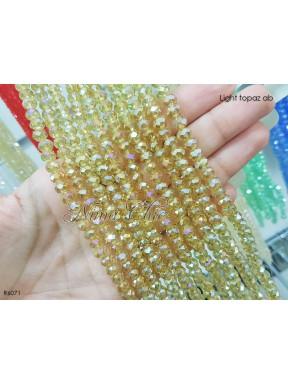 1 Filo di Cipollotti 6mm in cristallo sfaccettato Light topaz ab